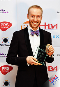 Daniel Edwards collecting the Best Specialist Music Award